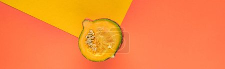 Photo for Top view of pumpkin on yellow and orange background with copy space, panoramic shot - Royalty Free Image
