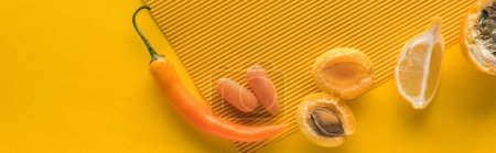 top view of fruits and vegetables on yellow background, panoramic shot