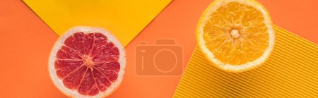 Photo for Top view of grapefruit and orange on yellow background, panoramic shot - Royalty Free Image