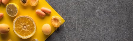 Photo for Top view of fruits and vegetables on yellow and grey background, panoramic shot - Royalty Free Image