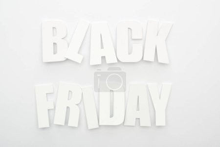 Photo for Top view of black Friday lettering on white background - Royalty Free Image