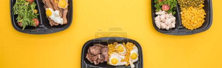 Photo for Panoramic shot of eco packages with vegetables, meat, fried eggs and salads isolated on yellow - Royalty Free Image