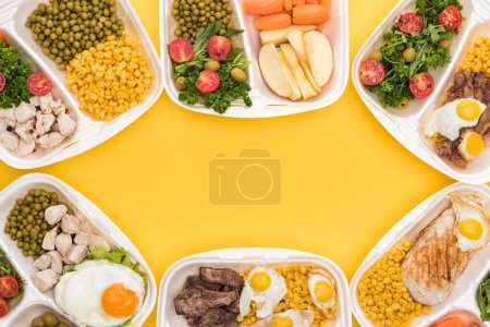 Photo for Top view of eco packages with apples, vegetables, meat, fried eggs and salads isolated on yellow - Royalty Free Image