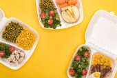 """Постер, картина, фотообои """"top view of eco packages with apples, vegetables, meat, fried egg and salads isolated on yellow """""""