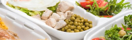 Photo for Panoramic shot of eco package with green peas, meat and salad on white background - Royalty Free Image