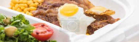 Photo for Panoramic shot of eco package with corn, meat, fried egg and salad on white background - Royalty Free Image