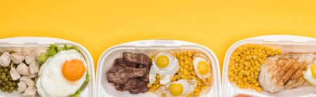 Photo for Panoramic shot of eco packages with vegetables, meat, fried eggs isolated on yellow - Royalty Free Image