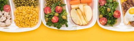 Photo for Panoramic shot of eco packages with vegetables, apples, meat, fried egg and salads isolated on yellow - Royalty Free Image