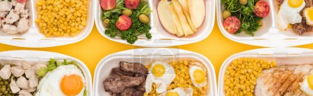 Photo for Panoramic shot of eco packages with vegetables, apples, meat, fried eggs and salads isolated on yellow - Royalty Free Image