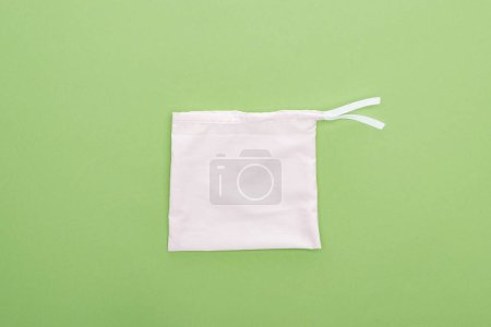 Photo for Top view of in eco friendly bag isolated on green - Royalty Free Image