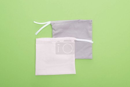 Photo for Top view of eco friendly bags isolated on green - Royalty Free Image