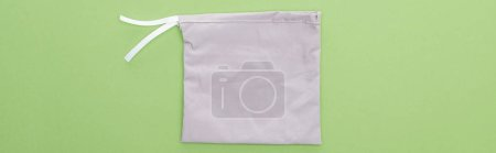 Photo for Top view of eco friendly grey bag isolated on green, panoramic shot - Royalty Free Image