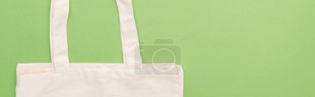 Photo for Top view of empty cotton eco bag isolated on green, panoramic shot - Royalty Free Image