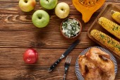 """Постер, картина, фотообои """"top view of apples, roasted turkey, pumpkin and grilled corn served on wooden table"""""""