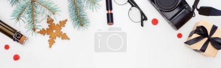 Foto de Panoramic shot of digital camera, fir branch, glasses, lipstick, gift box, toy snowflake isolated on white - Imagen libre de derechos