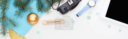 Photo for Panoramic shot of digital tablet, fir branch, wristwatch, christmas baubles, wooden block with december inscripton isolated on white - Royalty Free Image
