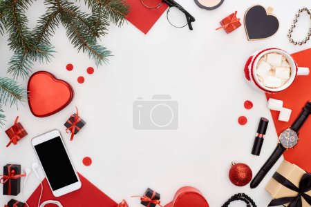 Photo pour Gift boxes, coffee with marshmallow, smartphone, fir branch, wristwatch, cosmetics, christmas baubles, glasses, wristwatch isolated on white - image libre de droit