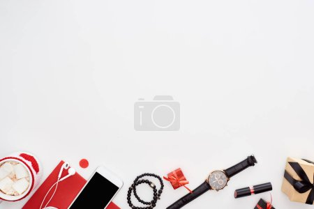 Photo for Coffee with marshmallow, smartphone, gift boxes, wristwatch, earphones, bracelets, lipsctick, red paper isolated on white - Royalty Free Image