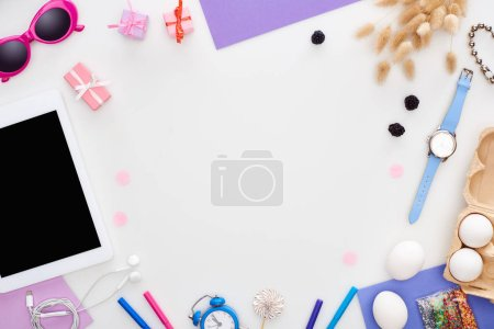 Photo for Digital tablet, sunglasses, pastry sprinkles, chicken eggs, blackberry, spikelets, wristwatch, toy alarm clock, earphones isolated on white - Royalty Free Image
