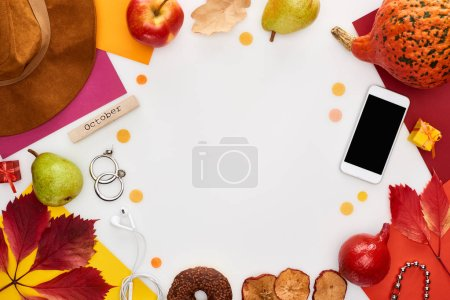 Photo for Hat, smartphone, fruits, pumpkin, dry leaves, multicolored papers, donut, coffee grains, wooden block with october inscription isolated on white - Royalty Free Image