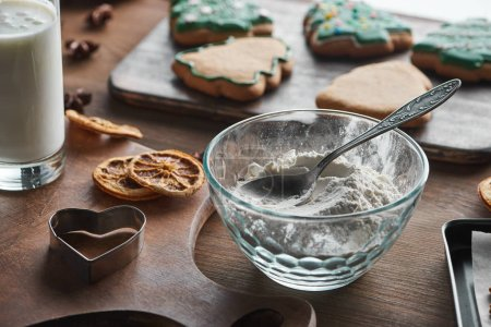 Photo for Selective focus of Christmas cookies ingredients on wooden table - Royalty Free Image