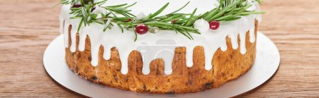 Photo for Christmas pie with glaze, rosemary and cranberries on wooden table - Royalty Free Image