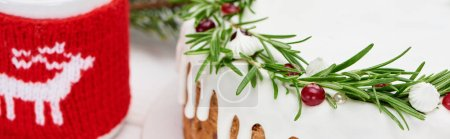 Photo for Close up of christmas pie with rosemary and cranberries on white wooden table with cocoa - Royalty Free Image