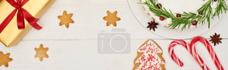 Photo for Top view of christmas pie, cookies and gift box on white wooden table - Royalty Free Image