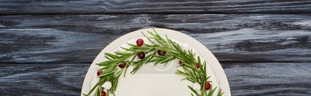 Photo for Top view of traditional christmas pie with glaze, rosemary and cranberries on dark wooden table - Royalty Free Image