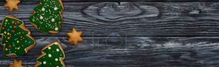 Photo for Top view of sweet christmas tree cookies on dark wooden table - Royalty Free Image