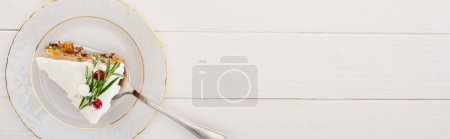 Photo for Top view of piece of christmas pie on plate on white wooden table - Royalty Free Image