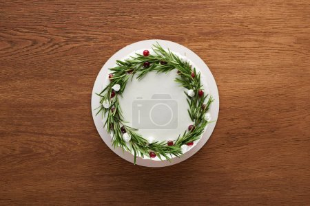 Photo for Top view of traditional christmas pie with rosemary and cranberries on wooden table - Royalty Free Image