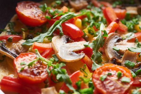 Photo for Close up of delicious homemade omelet with mushrooms, tomatoes and greens - Royalty Free Image