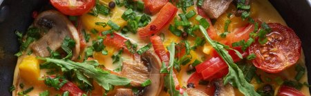 Photo for Top view of yummy homemade omelet with mushrooms, tomatoes and greens - Royalty Free Image