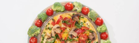 Photo for Top view of yummy omelet on plate with fresh tomatoes and broccoli - Royalty Free Image