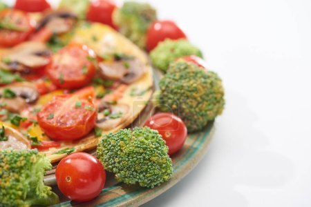 Photo for Close up of homemade yummy omelet on plate with fresh tomatoes and broccoli - Royalty Free Image