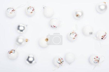 Foto de Top view of silver and  white baubles on white background - Imagen libre de derechos