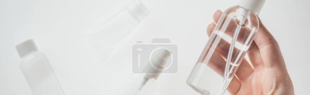 Photo for Panoramic shot of woman holding bottle with liquid on white background - Royalty Free Image