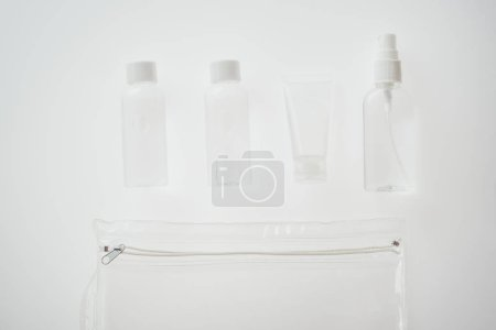 Photo for Top view of bottles and tube with liquids on white background - Royalty Free Image