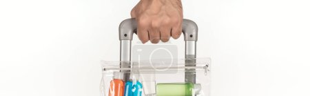 Photo for Panoramic shot of man holding travel bag with cosmetic bag with colorful bottles with liquids isolated on white - Royalty Free Image