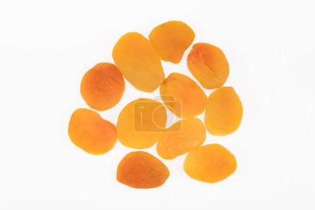 Photo for Top view of delicious dried apricots isolated on white - Royalty Free Image