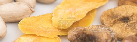 Photo for Close up view of pistachio nuts, dried mango and figs isolated on white, panoramic shot - Royalty Free Image