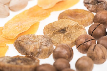 Photo for Close up view of dried mango slices, figs and macadamia nuts isolated on white - Royalty Free Image