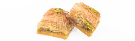 Photo for Traditional turkish honey baklava with nuts isolated on white, panoramic shot - Royalty Free Image