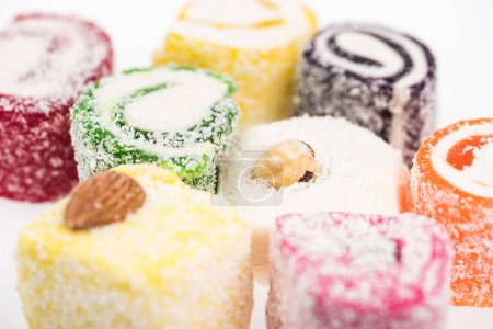 Photo for Close up view of assorted delicious turkish delight in coconut flakes isolated on white - Royalty Free Image