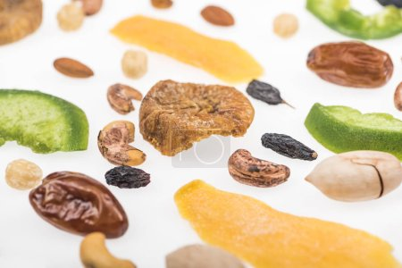 Photo for Close up view of tasty assorted nuts, dried fruits and candied fruit isolated on white - Royalty Free Image