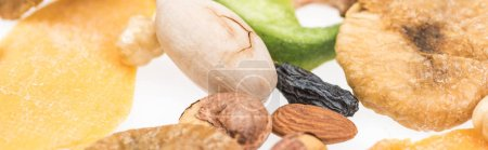 Photo for Close up view of Turkish assorted nuts, dried fruits and candied fruit isolated on white, panoramic shot - Royalty Free Image