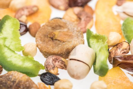 Photo for Close up view of Turkish assorted nuts, dried fruits and candied fruit isolated on white - Royalty Free Image