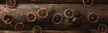 Photo for Top view of dried citrus slices on wooden background, panoramic shot - Royalty Free Image