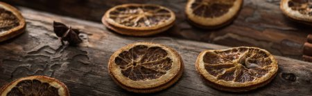 dried citrus slices with anise on wooden background, panoramic shot